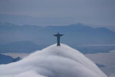 http://twistedsifter.files.wordpress.com/2012/07/clouds-fog-rolling-over-christ-the-redeemer-in-rio-de-janeior-brazil.jpg