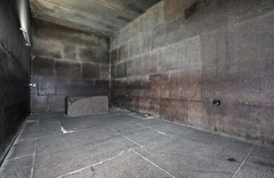 """The King's Chamber is 10.47 metres (34.4 ft) from east to west and 5.234 metres (17.17 ft) north to south. It has a flat roof 5.974 metres (19.60 ft) above the floor. 0.91 m (3.0 ft) above the floor there are two narrow shafts in the north and south walls (one is now filled by an extractor fan to try to circulate air in the pyramid). The purpose of these shafts is not clear: they appear to be aligned toward stars or areas of the northern and southern skies, but on the other hand one of them follows a dog-leg course through the masonry so there was not intention to directly sight stars through them. They were long believed by Egyptologists to be """"air shafts"""" for ventilation, but this idea has now been widely abandoned in favor of the shafts serving a ritualistic purpose associated with the ascension of the king's spirit to the heavens.[32]The King's Chamber is entirely faced with granite. Above the roof, which is formed of nine slabs of stone weighing in total about 400 tons, are five compartments known as Relieving Chambers. The first four, like the King's Chamber, have flat roofs formed by the floor of the chamber above, but the final chamber has a pointed roof. Vyse suspected the presence of upper chambers when he found that he could push a long reed through a crack in the ceiling of the first chamber. From lower to upper, the chambers are known as """"Davison's Chamber"""", """"Wellington's Chamber"""", """"Nelson's Chamber"""", """"Lady Arbuthnot's Chamber"""", and """"Campbell's Chamber"""". It is believed that the compartments were intended to safeguard the King's Chamber from the possibility of a roof collapsing under the weight of stone above the Chamber. As the chambers were not intended to be seen, they were not finished in any way and a few of the stones still retain mason's marks painted on them. One of the stones in Campbell's Chamber bears a mark, apparently the name of a work gang, which incorporates the only reference in the pyramid to Pharaoh Khufu.[33][34]The entrance of the"""