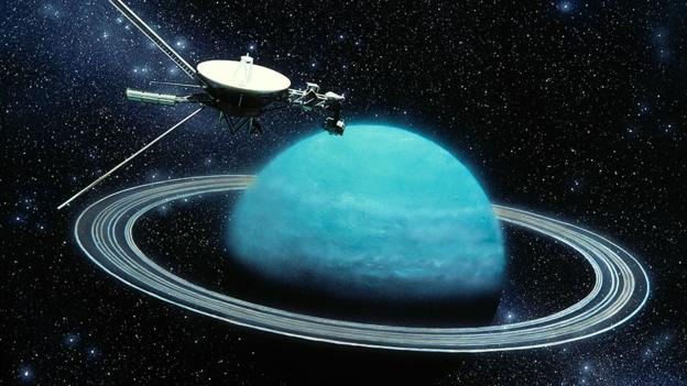 This artwork, by Julian Baum, shows the Voyager 2 spaceprobe less than an hour from closest approach to the planet Uranus on 24 January 1986. Uranus is one of the four great gas giants. It is unique in that its equator, along with its moons and tenuous ring system, is tilted at 98 degrees to the plane of the Solar System. Because of this, Voyager's encounter with the planet and its satellites lasted only about six hours. It also means that in alternate seasons Uranus' poles and equator in turn face the Sun. Uranus orbits the Sun once in 84 years and, at present, the planet's south pole faces the Sun, in the midst of a 21-year long summer.