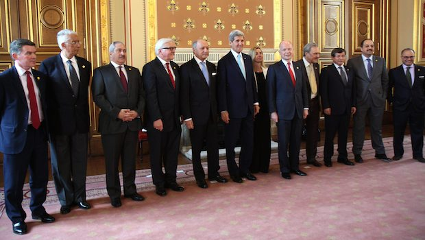 epa04207086 A handout photograph made available by the British Foreign and Commonwealth Office showing a group photograph before the start of 'London 11' Friends of Syria Meeting in London, England, 15 May 2014. Eleven foreign ministers from the Friends of Syria group were meeting, in an effort to reinvigorate the Syrian peace process and step up their support for the opposition. The London meeting comes just days after international peace envoy Lakhdar Brahimi resigned and less than three weeks before Syrian President Bashar al-Assad is seeking re-election for a third seven-year term. EPA/BRITISH FOREIGN AND COMMONWEALTH OFFICE HANDOUT EDITORIAL USE ONLY/NO SALES
